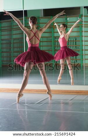 Beautiful dancer ballerina with reflection - stock photo