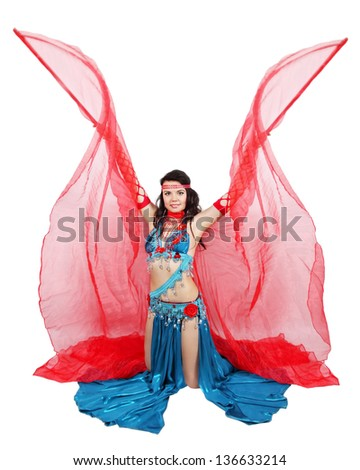 Beautiful dancer in eastern costume with wings - stock photo