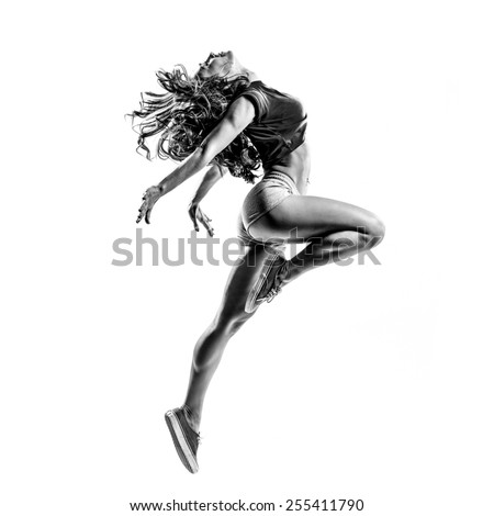 beautiful dancer jumping on a white isolated background in black and white color. high contrast black and white image - stock photo