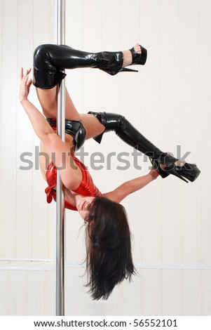 beautiful dancer on the pole. - stock photo