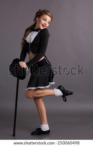 Beautiful dancer wearing black gentleman costume - stock photo
