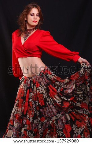 Beautiful dancer wearing red top and floral dress  - stock photo