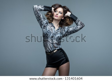 Beautiful dancing girl on blue background