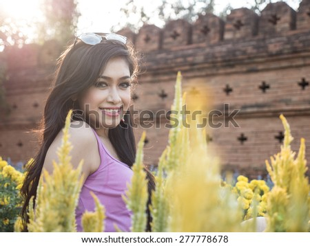 Beautiful Dark Haired Thai Asian Model Poses in Outdoor Natural Setting - stock photo