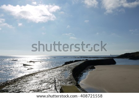 Beautiful day at Cullercoats harbour on the Northumberland coastline, England - stock photo