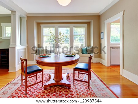 Beautiful decor of dining room with beige, blue and red. - stock photo