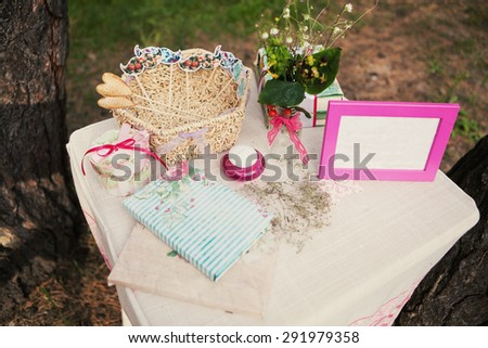 Beautiful decor on the table with a photo frame and flowers