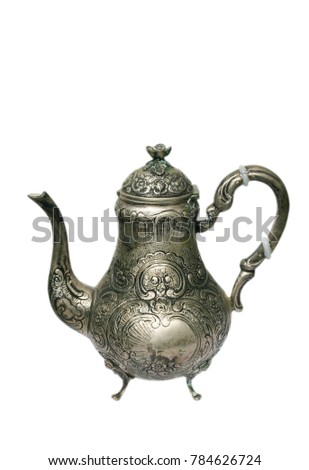 Beautiful decorated antique silver pot at the white background