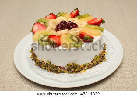 Beautiful decorated fruit cake with nuts - stock photo