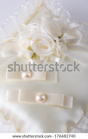 Beautiful decorated ring cushion for weddings. - stock photo