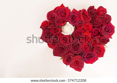 Beautiful decoration with flowers. A bouquet of roses. And cover in the shape of a heart.