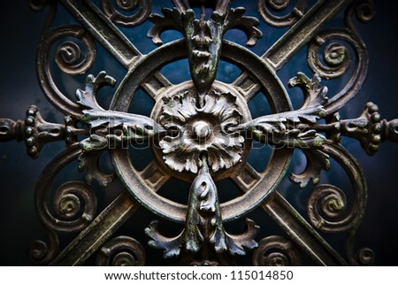 Beautiful, decorative antique flowers made of metal on a big cathedral's door - stock photo