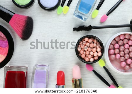 Beautiful decorative cosmetics and makeup brushes, isolated on white - stock photo