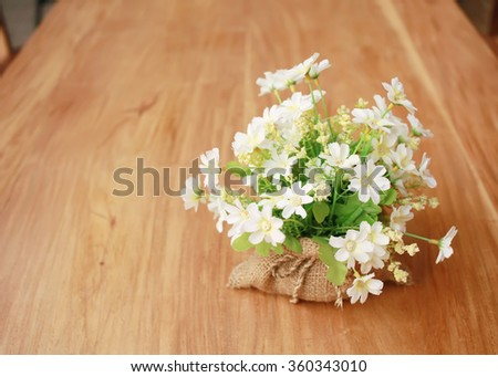 Beautiful Decorative flower on wooden table,home interior decoration.