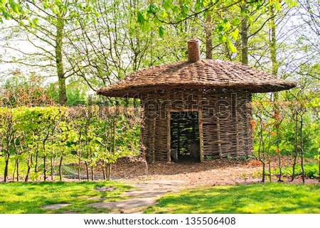 Beautiful decorative hut in the garden - stock photo