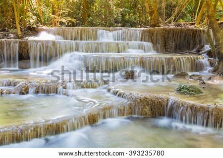 Beautiful deep forest national park, blue stram waterfall - stock photo