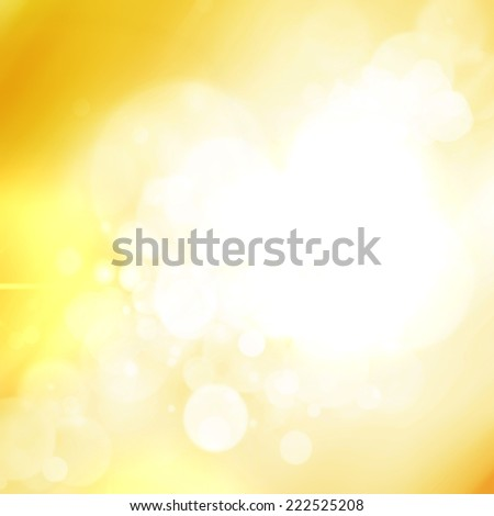 Beautiful defocused abstract white holiday lights on yellow background. Gold Festive Christmas background.  - stock photo