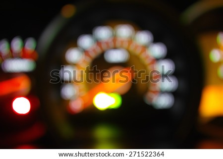 Beautiful defocused car meter filtered bokeh abstract with orange tone background. - stock photo