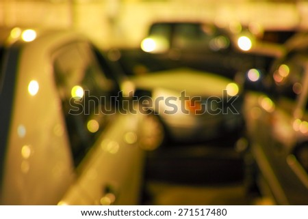 Beautiful defocused city night filtered bokeh abstract with car background. - stock photo