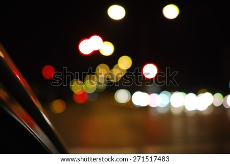 Beautiful defocused city night filtered bokeh abstract with town background.