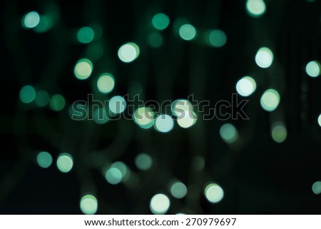 Beautiful defocused LED lights  filtered bokeh abstract with green tone background.