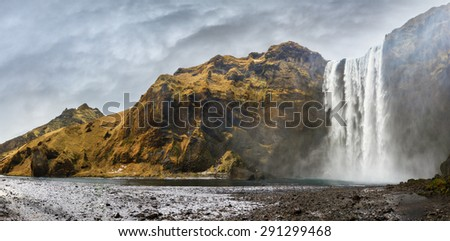 Beautiful 180 degree panorama of the magnificent Skogafoss waterfall in Iceland - stock photo
