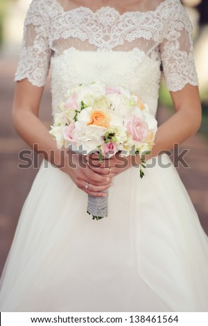 Beautiful delicate bride with her wedding bouquet
