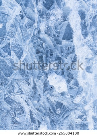 beautiful delicate patterns on the surface of the crystal clear blue ice on the lake in the winter in December before Christmas - stock photo