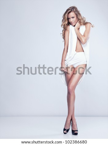 Beautiful delicate woman in white lingerie - stock photo