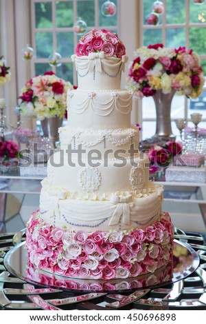 Beautiful, delicious, and super well-decorated wedding cake. - stock photo