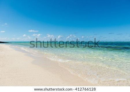 Beautiful desert beach in Mauritius Island. Summer time in paradise tropical island with white sandy beach and turquoise water. Gorgeous weather