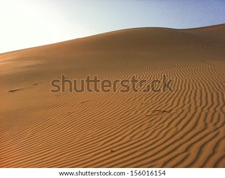 beautiful desert dunes and sand textures in the sahara desert. - stock photo