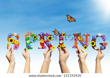 Beautiful design with spring letter hold by many hands under blue sky