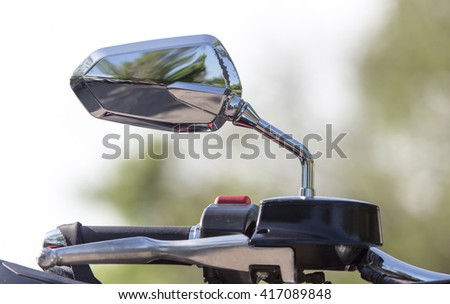 beautiful detail of the motorcycle. mirror - stock photo