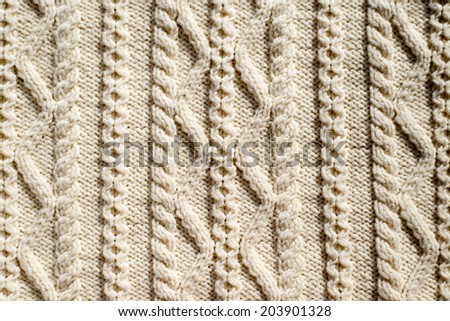 beautiful detail of woven hand made knit woolen design texture and knitting needle. Fabric element white copy space background - stock photo