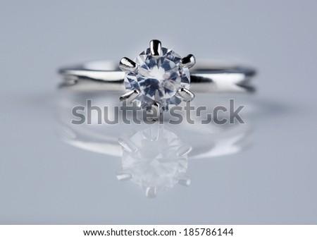 Beautiful diamond ring on light background - stock photo