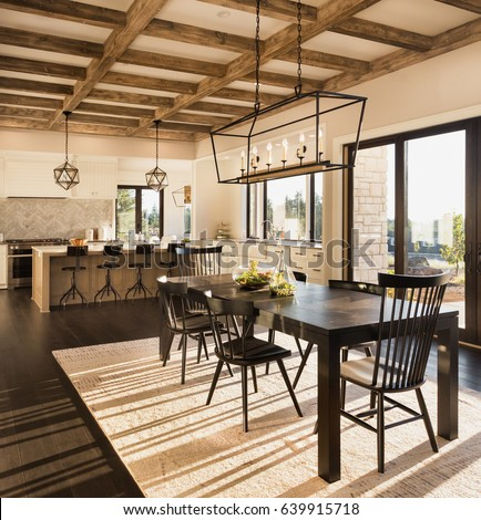 Beautiful Dining Room And Kitchen In New Luxury Home At Sunrise House Features Wood Beam