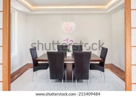 Beautiful Dining Room in Luxury Home  with Soji Doors - stock photo