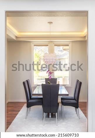 Beautiful Dining Room in New Home with Tray lighting - stock photo