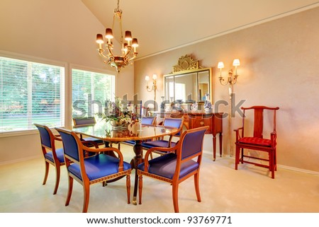 Beautiful dining room with blue antique chairs - stock photo