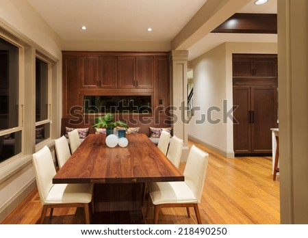 Beautiful Dining Room with Fish Tank in New Luxury Home - stock photo
