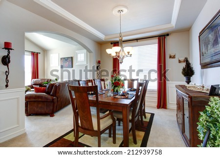 Beautiful dining room with wooden dining table and cabinet