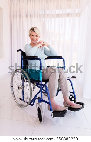 beautiful disabled mid age woman looking at the camera - stock photo