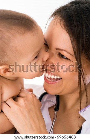 beautiful doctor and newborn on a white background