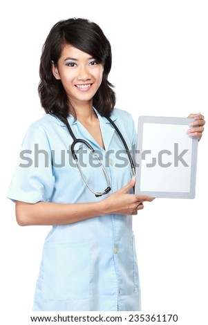 Beautiful doctor showing blank tablet computer isolated over white background - stock photo