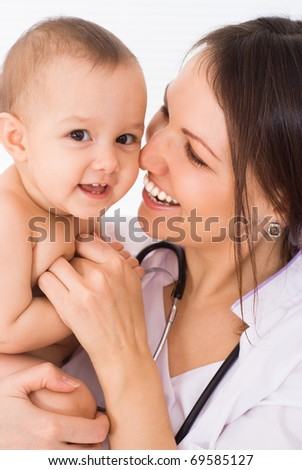 beautiful doctor with baby on a white background - stock photo