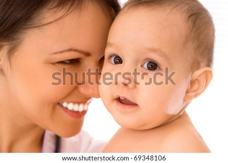 beautiful doctor with newborn on a white