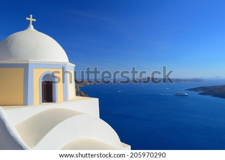 Beautiful domed church and the volcanic caldera with ships in the distance, sunset, Fira, Santorini - Thira, Cyclades islands, Greece