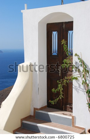 Beautiful door in white frame on the island of Santorini