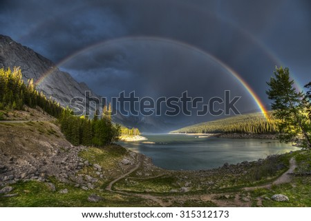 Beautiful double rainbow over scenic Medicine Lake, Jasper National Park in the Canadian Rocky Mountains